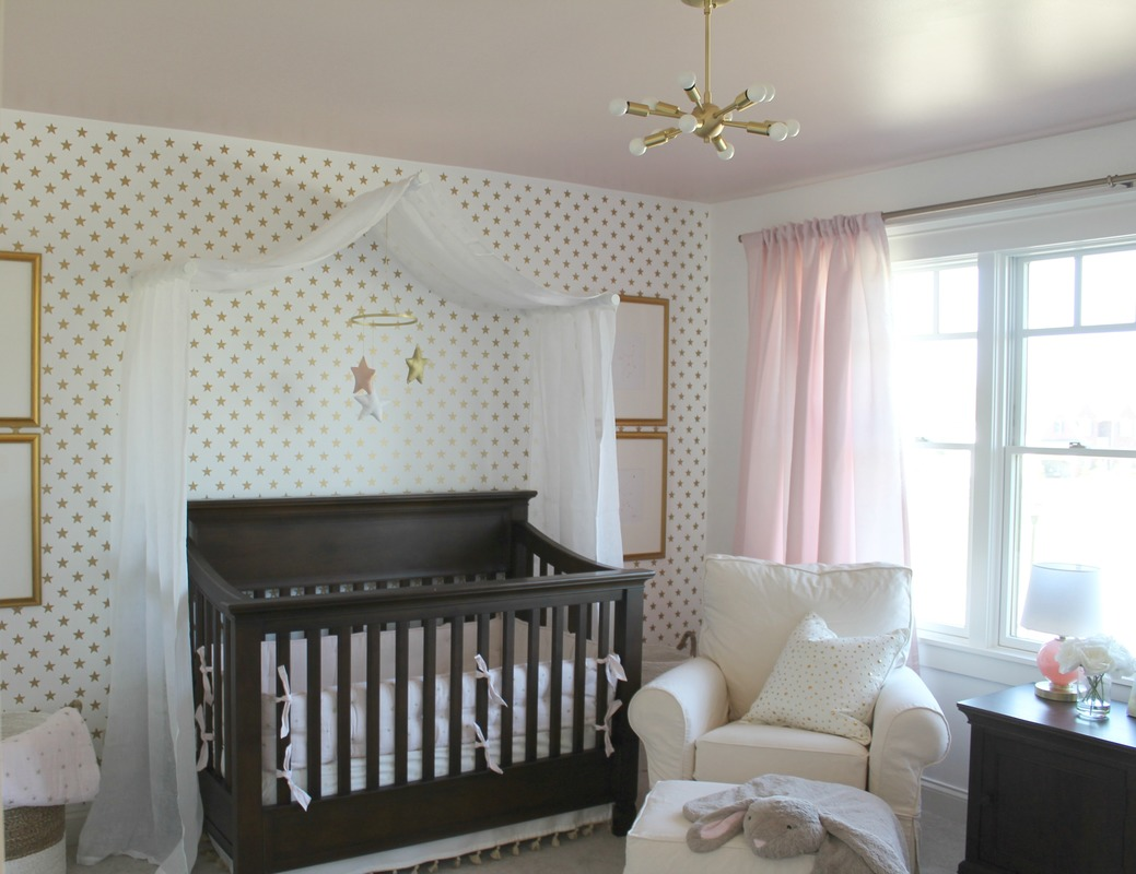 Nursery pear design studio a nursery worth its weight in gold this stunning nursery has a soft pink color palette with accents of gold this stenciled feature wall is a french poem amipublicfo Choice Image